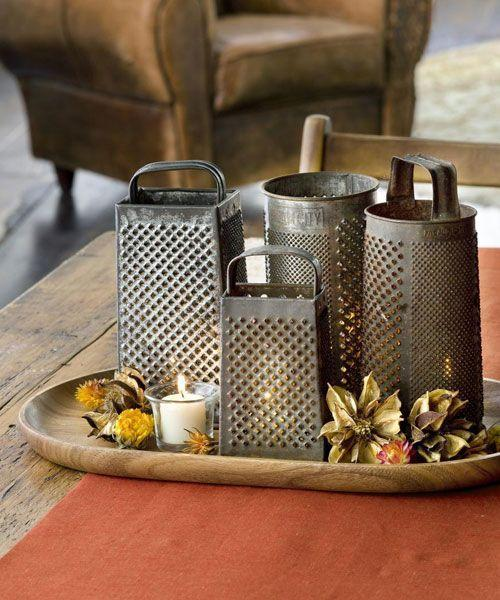 <p>Cast twinkling light across the tabletop with a collection of these yard sale finds. When the lights do down, the cheese grater create a glimmering effect.</p>