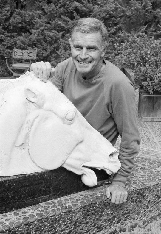 <p>Heston posed with the sculpture in 1983, part of a photo shoot to publicize his return to TV drama (as a politician in the miniseries <i>Chiefs</i>) after a 15-year absence.<i> (Photo: Wally Fong/AP)</i><br /></p>