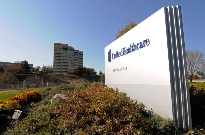 FILE - This Oct. 16, 2012, file photo, shows a portion of the UnitedHealth Group Inc.'s campus in Minnetonka, Minn. The nation's biggest health insurer is expanding a program that passes rebates from drugmakers directly to the people that use their medications. UnitedHealthcare said Tuesday, March 12, 2019, that next year, all of its new, employer-sponsored healthcare plans must give point-of-sale discounts to consumers when they pick up medications. (AP Photo/Jim Mone, File)