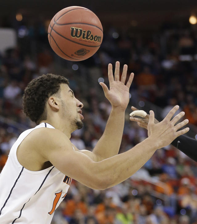 Virginia forward Anthony Gill (13) tries to control the ball against Coastal Carolina during the first half of an NCAA college basketball second-round tournament game, Friday, March 21, 2014, in Raleigh. (AP Photo/Gerry Broome)