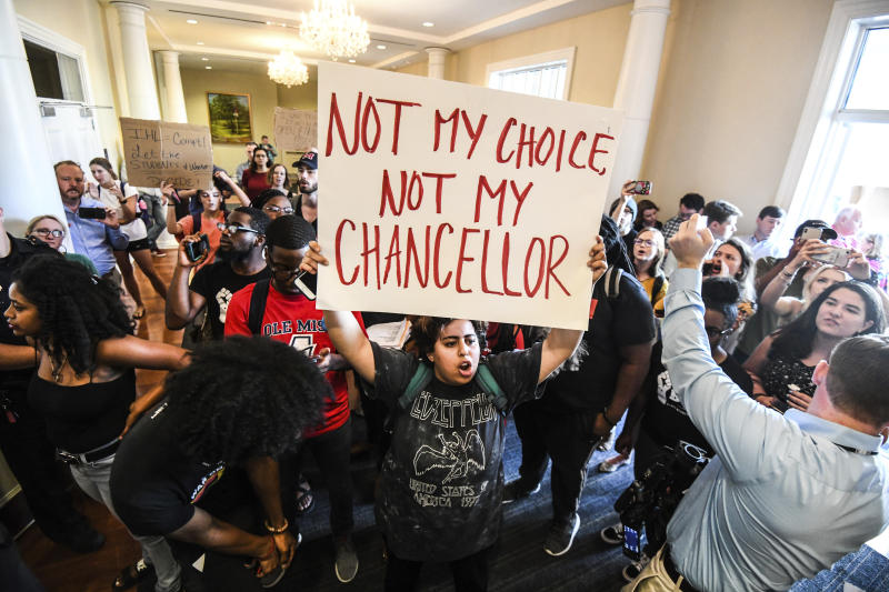 Protesters chant after a news conference that was supposed to name former Mississippi Higher Education Commissioner Glenn Boyce as the new chancellor at the University of Mississippi was cancelled, Friday, Oct. 4, 2019, in Oxford, Miss. (Bruce Newman/The Oxford Eagle via AP)
