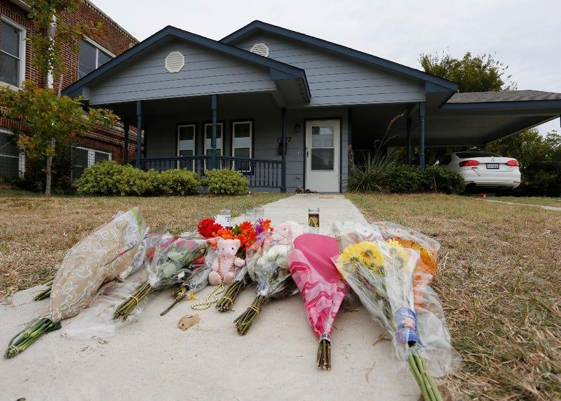 In this Monday, Oct. 14, 2019 photo, flowers lie on the sidewalk in front of the house in Fort Worth, Texas, where a white Fort Worth police officer Aaron Dean shot and killed Atatiana Jefferson, a black woman, through a back window of her home. Dean was not heard identifying himself as police on the bodycam video, and Interim Police Chief Ed Kraus has said there was no sign Dean or the other officer who responded even knocked on the front door. Dean resigned before being charged with murder.