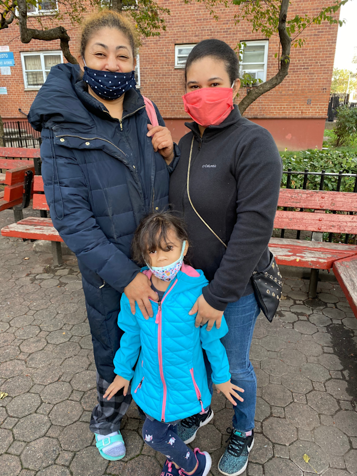 Marleny Hernandez outside her apartment in East Harlem with her mother, Nancy, and daughter, Anjerlin.
