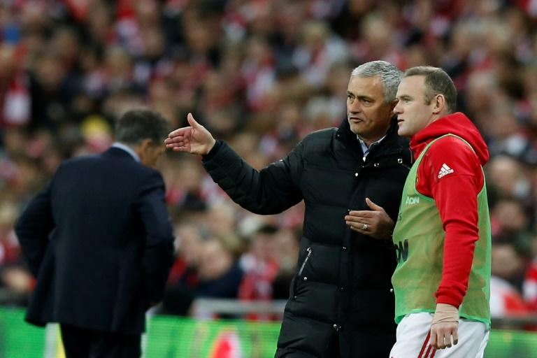 "Manchester United's manager Jose Mourinho (L), pictured in February 2017, has said that Wayne Rooney (R) will ""100 percent be with us"" until the end of this season, but he can't say with certainty where Rooney will be next year"