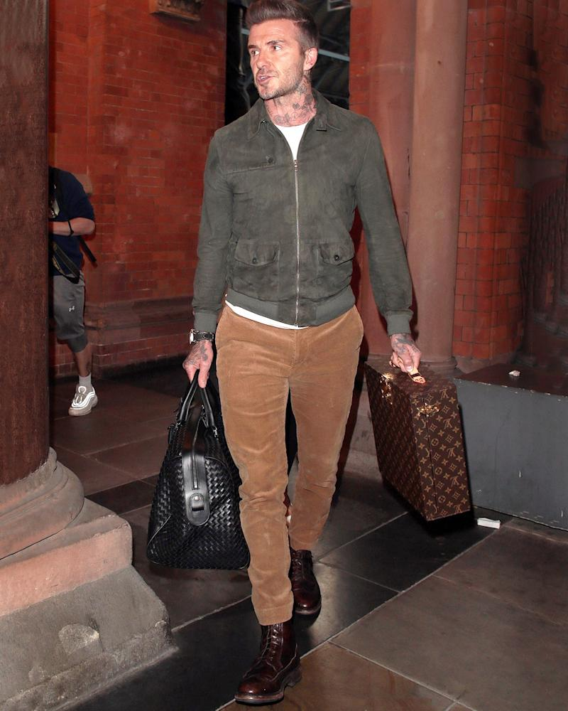 Yes, David Beckham's fit is big—but the Louis Vuitton suitcase is massive.
