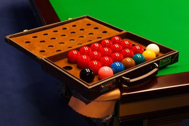 Snooker balls are lined up in a suitcase (PA)
