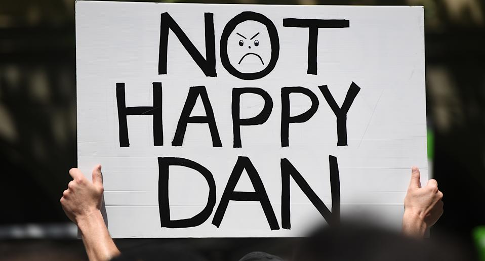 A sign reads 'Not Happy Dan' at a protest where hundreds were arrested on Tuesday.