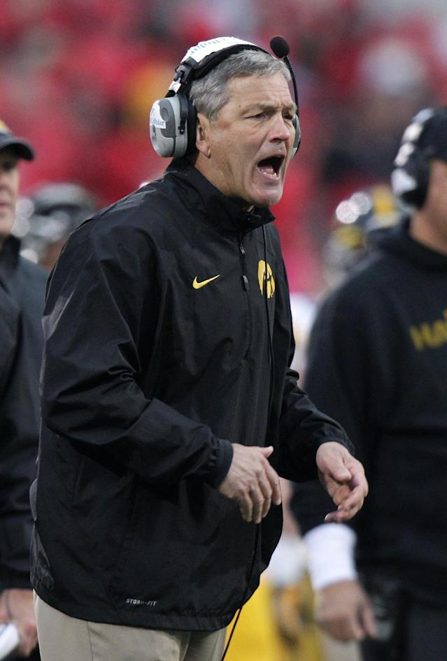 Iowa head coach Kirk Ferentz yells on the sideline in the fourth quater against Ohio State during an NCAA college football game Saturday, Oct. 19, 2013, in Columbus, Ohio. Ohio State beat Iowa 34-24. (AP Photo/Jay LaPrete)