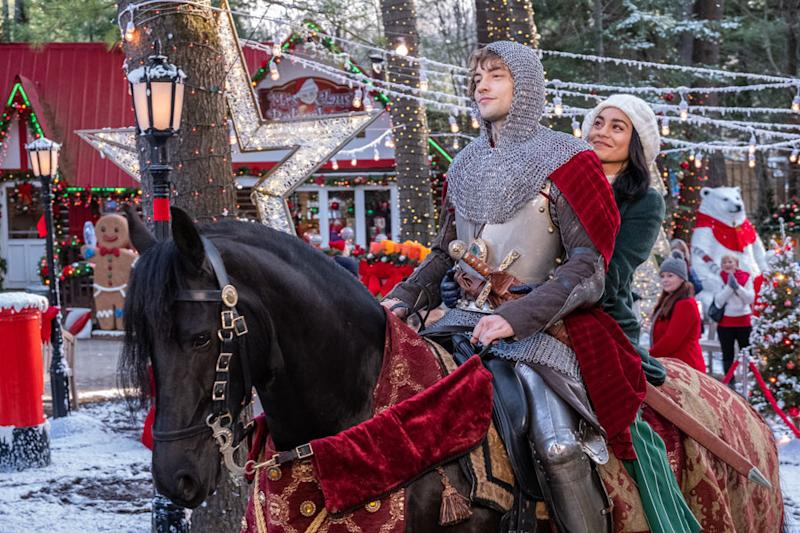 Vanessa Hudgens and Josh Whitehouse on a horse in Netflix's The Knight Before Christmas.