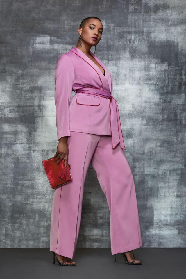 """<p>Opt for a super-chic pink satin two-piece suit that will have you looking like the boss you are! You can make the look instantly sexy by pairing your look with a lace bralette underneath.<br /><a rel=""""nofollow"""" href=""""https://fave.co/2UXRgfp""""><strong>Shop it:</strong></a> Piping Trimmed Blazer With Belt, $130, <a rel=""""nofollow"""" href=""""https://fave.co/2UXRgfp"""">eloquii.com</a><br /><a rel=""""nofollow"""" href=""""https://fave.co/2R5h622""""><strong>Shop it:</strong></a> Wide Leg Trouser With Piping, $95, <a rel=""""nofollow"""" href=""""https://fave.co/2R5h622"""">eloquii.com</a> </p>"""