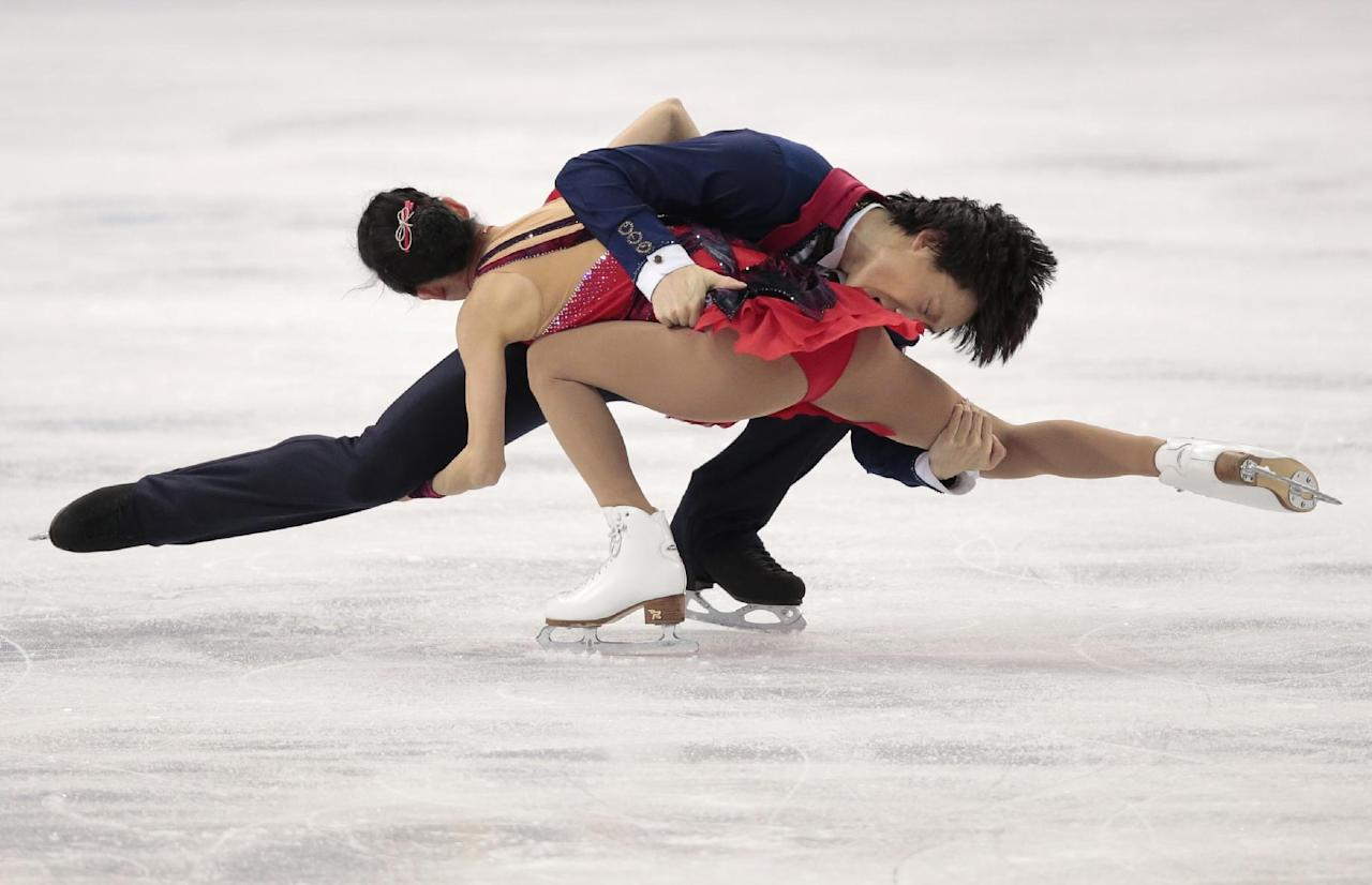 Pang Qing and Tong Jian of China compete in the pairs free skate figure skating competition at the Iceberg Skating Palace during the 2014 Winter Olympics, Wednesday, Feb. 12, 2014, in Sochi, Russia. (AP Photo/Ivan Sekretarev)