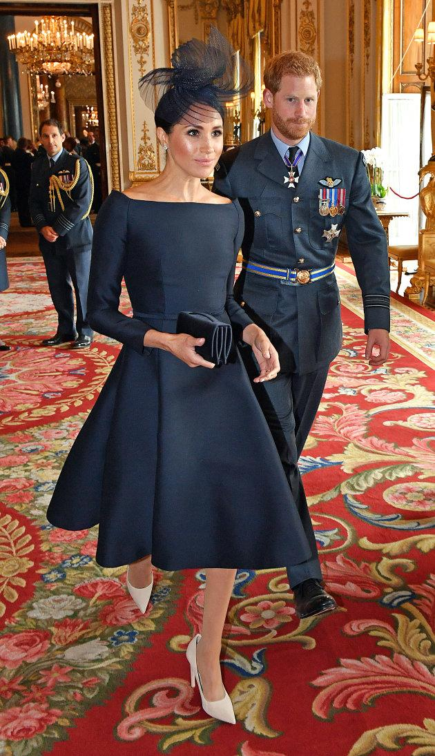 Meghan Markle wears a Dior dress at a reception to mark the centenary of the Royal Air Force on July 10, 2018.