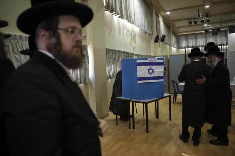 Ultra orthodox Jews wait for Rabbi Israel Hager to vote in Bnei Brak, Israel, Tuesday, Sept. 17, 2019. Israelis began voting Tuesday in an unprecedented repeat election that will decide whether longtime Prime Minister Benjamin Netanyahu stays in power despite a looming indictment on corruption charges. (AP Photo/Oded Balilty)