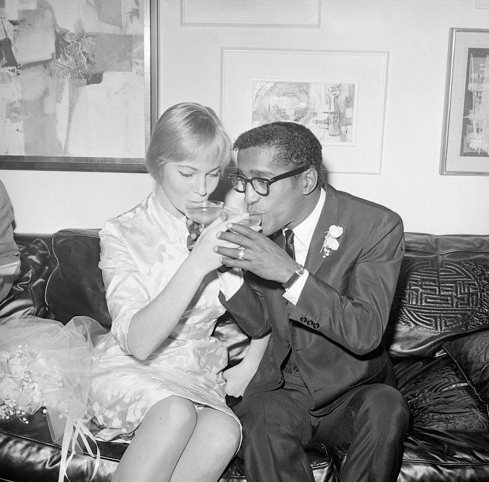 <p>May Britt and Sammy Davis Jr. share a champagne toast after becoming husband and wife in 1960. The couple opted for an intimate wedding ceremony followed by a reception at Davis's Hollywood home. <br></p>
