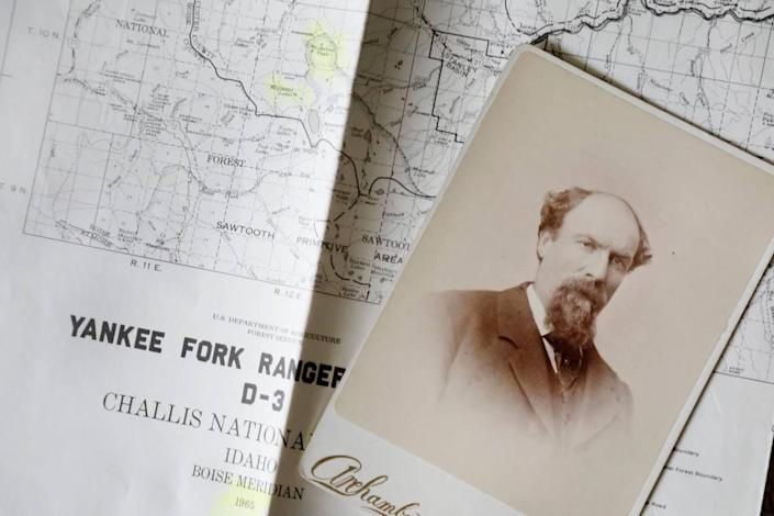 """A photo of the late George L. McGowan of Challis is pictured over a 1965 map showing the correct spelling of McGowan Peak, McGowan Lakes and McGowan Creek. In many maps and books it has been mistakenly printed as """"McGown."""""""