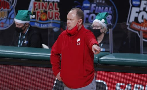 Wisconsin coach Greg Gard gives instructions against Michigan State during the second half of an NCAA college basketball game, Friday, Dec. 25, 2020, in East Lansing, Mich. Wisconsin won 85-76. (AP Photo/Al Goldis)
