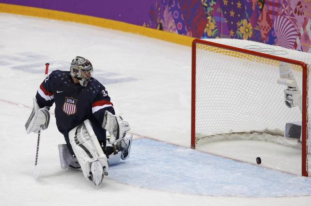 Team USA's goalie Jonathan Quick lets in a goal by Russia's Pavel Datsyuk (not shown) during the second period of their men's preliminary round ice hockey game at the 2014 Sochi Winter Olympics, February 15, 2014. REUTERS/Grigory Dukor (RUSSIA - Tags: SPORT ICE HOCKEY OLYMPICS)
