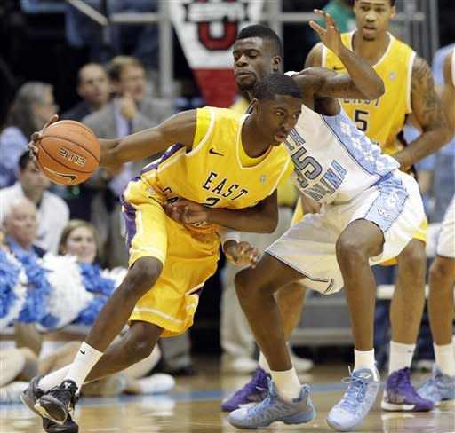 North Carolina's Reggie Bullock (35) guards East Carolina's Maurice Kemp (2) during the first half of an NCAA college basketball game in Chapel Hill, N.C., Saturday, Dec. 15, 2012. (AP Photo/Gerry Broome)