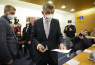 Czech Republic's Prime Minister and leader of centrist ANO (YES) movement Andrej Babis holds his ballot at a polling station in Lovosice, Czech Republic, Friday, Oct. 8, 2021. Czechs begin voting in a parliamentary election with polls showing Prime Minister Andrej Babis, a populist billionaire, has a good chance of keeping his job, despite a new scandal over his financial dealings. (AP Photo/Petr David Josek)
