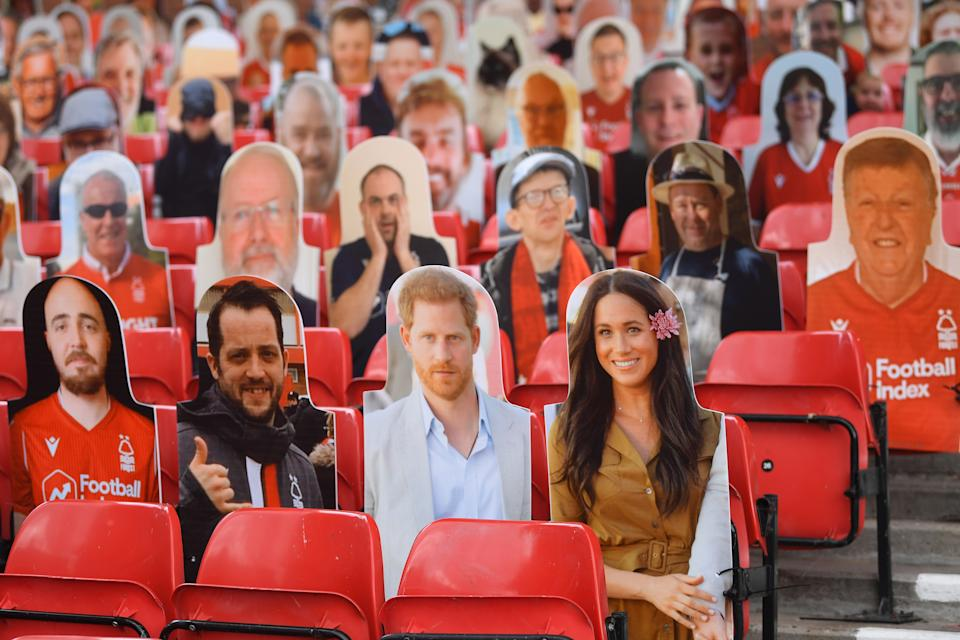 NOTTINGHAM, ENGLAND - JUNE 28: Harry and Meghan the Duke and Duchess of Sussex look out amongst the cardboard fans profile pictures in the main stand ahead of the Sky Bet Championship match between Nottingham Forest and Huddersfield Town at City Ground on June 28, 2020 in Nottingham, England. (Photo by Laurence Griffiths/Getty Images)