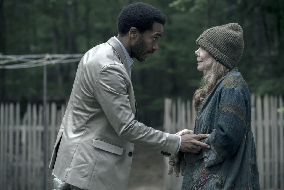 """This image released by Hulu shows Andre Holland, left, and Sissy Spacek in a scene from """"Castle Rock,"""" premiering July 25 on Hulu. (Patrick Harbron/Hulu via AP)"""