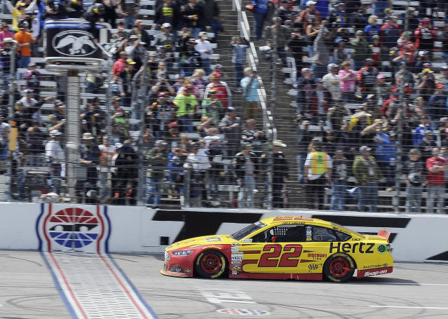Joey Logano crosses the finish line to win the NASCAR Sprint Cup series auto race at Texas Motor Speedway, Monday, April 7, 2014, in Fort Worth, Texas. (AP Photo/Larry Papke)