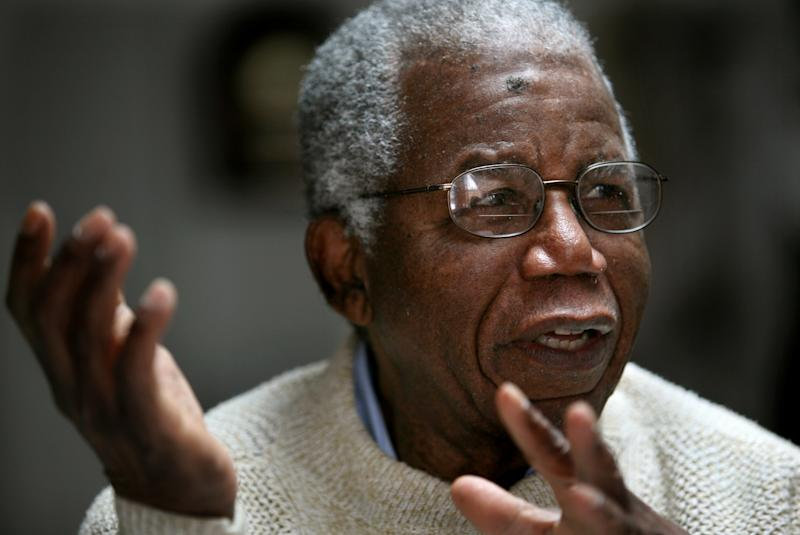 """FILE - Chinua Achebe, Nigerian-born novelist and poet speaks about his works and his life at his home on the campus of Bard College in Annandale-on-Hudson, New York where he is a professor, in this Jan. 22, 2008 file photo. Achebe, who wrote the classic """"Things Fall Apart,"""" has died. He was 82. Achebe's publisher confirmed his death Friday, March 22, 2013. (AP Photo/Craig Ruttle, File)"""