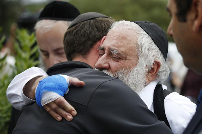 Rabbi Yisroel Goldstein hugs a member of the congregation of Chabad of Poway, Calif., the day after a deadly shooting took place there in April. (Photo: TNS via ZUMA Wire)