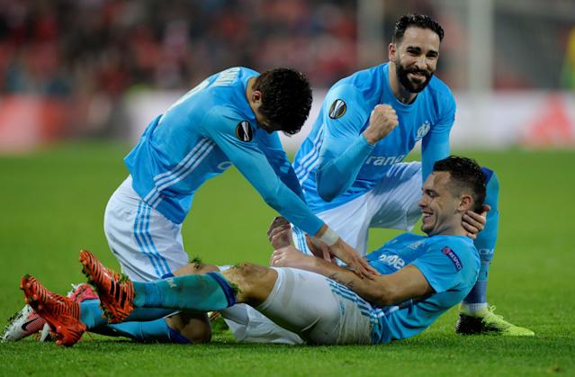 Soccer Football - Europa League Round of 16 Second Leg - Athletic Bilbao vs Olympique de Marseille - San Mames, Bilbao, Spain - March 15, 2018 Marseille's Lucas Ocampos celebrates with Hiroki Sakai and Adil Rami after scoring their second goal REUTERS/Vincent West