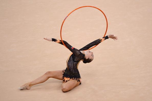 LONDON, ENGLAND - AUGUST 09: Liubou Charkashyna of Belarus competes in the Individual All-Around Gymnastics Rhythmic on Day 13 of the London 2012 Olympics Games at Wembley Arena on August 9, 2012 in London, England.  (Photo by Michael Regan/Getty Images)