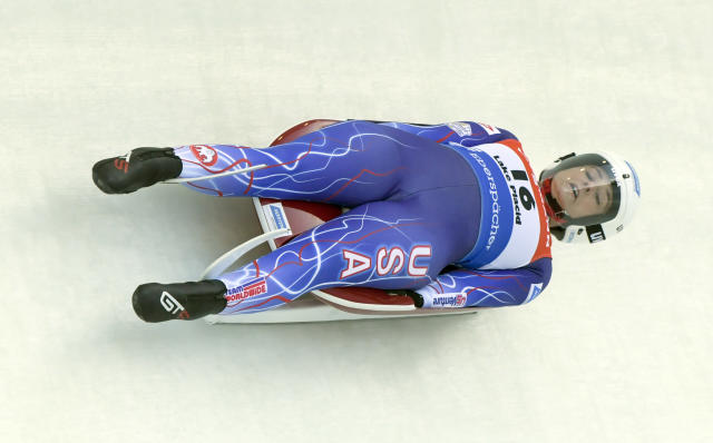 Emily Sweeney, of the United States, take a turn during the first run of a women's World Cup luge event in Lake Placid, N.Y., on Saturday, Nov. 30, 2019. (AP Photo/Hans Pennink)