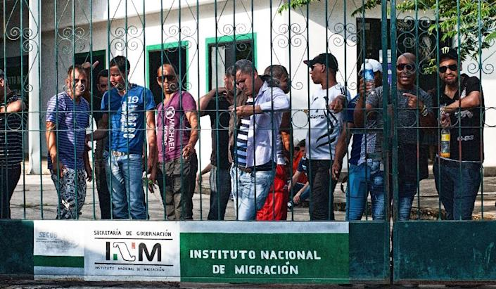 A group of Cuban migrants wait outside the National Institute of Migrations in Tapachula, Chiapas state, in Mexico on November 3, 2015 (AFP Photo/Pep Companys)