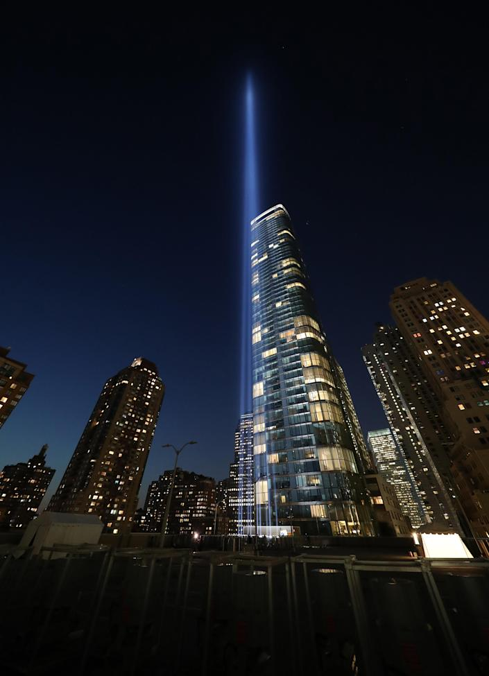 <p>Lights installed on the roof of the Battery Parking Garage, south of the 9/11 Memorial, send twin beams up to four miles into the sky on Sept. 5, 2018. (Photo: Gordon Donovan/Yahoo News) </p>
