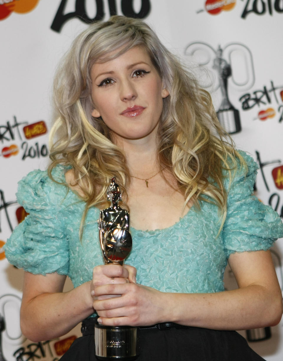 Ellie Goulding reacts to the media with her Critics Choice Brit award at the Brit Awards 2010 in London, Tuesday, Feb. 16, 2010. (AP Photo/Alastair Grant)