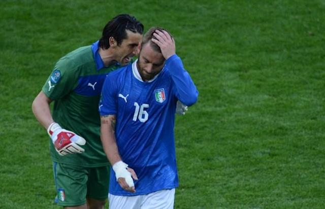 Italian goalkeeper Gianluigi Buffon (L) reacts with Italian midfielder Daniele De Rossithe Euro 2012 championships football match Spain vs Italy on June 10, 2012 at the Gdansk Arena. The game ended in a draw 1-1. AFPPHOTO/ PATRIK STOLLARZPATRIK STOLLARZ/AFP/GettyImages
