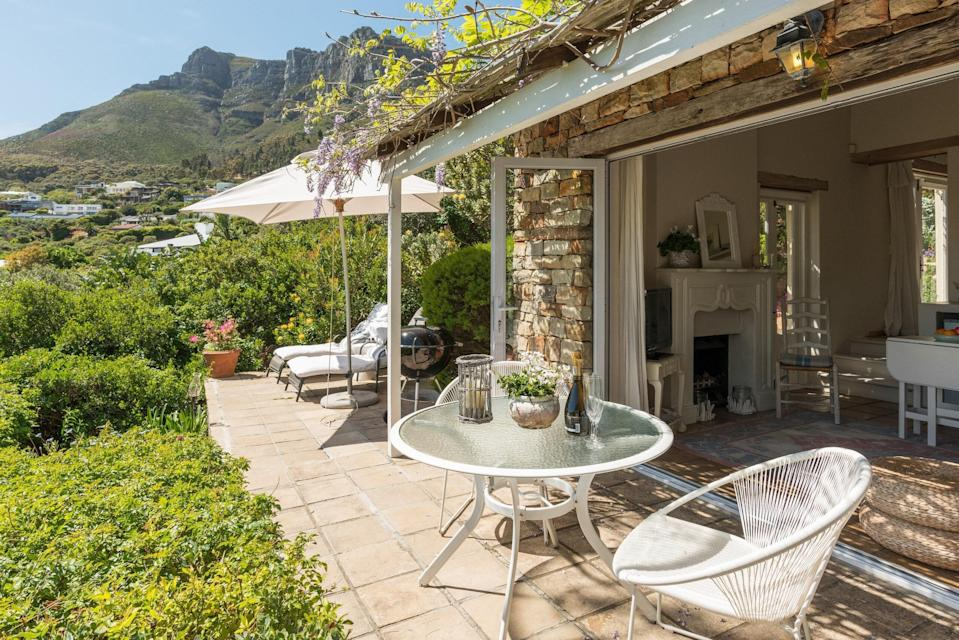 """<p>Located about 20 minutes from <a href=""""https://www.cntraveler.com/story/cape-town-central-business-district-guide?mbid=synd_yahoo_rss"""" rel=""""nofollow noopener"""" target=""""_blank"""" data-ylk=""""slk:Cape Town's CBD"""" class=""""link rapid-noclick-resp"""">Cape Town's CBD</a> in the quiet, beachfront neighborhood of Lladudno, this cottage has incredible views of both the South Atlantic and Table Mountain from the patios and pool. (Despite <a href=""""https://www.cntraveler.com/galleries/2016-04-13/the-6-best-beaches-in-cape-town-south-africa?mbid=synd_yahoo_rss"""" rel=""""nofollow noopener"""" target=""""_blank"""" data-ylk=""""slk:the beach"""" class=""""link rapid-noclick-resp"""">the beach</a> being a mere eight-minute walk away, the ocean is frigid so the pool is a major plus.) The cozy interior space offers an all-in-one kitchen, living, and dining area (complete with a laundry machine and dishwasher), while the light-filled bedroom opens up to the outdoors. There are multiple outdoor seating areas, too, as well as a grill for evening braais. </p> <p><strong>Book now:</strong> <a href=""""https://airbnb.pvxt.net/B4KXq"""" rel=""""nofollow noopener"""" target=""""_blank"""" data-ylk=""""slk:From $93 per night, airbnb.com"""" class=""""link rapid-noclick-resp"""">From $93 per night, airbnb.com</a></p>"""