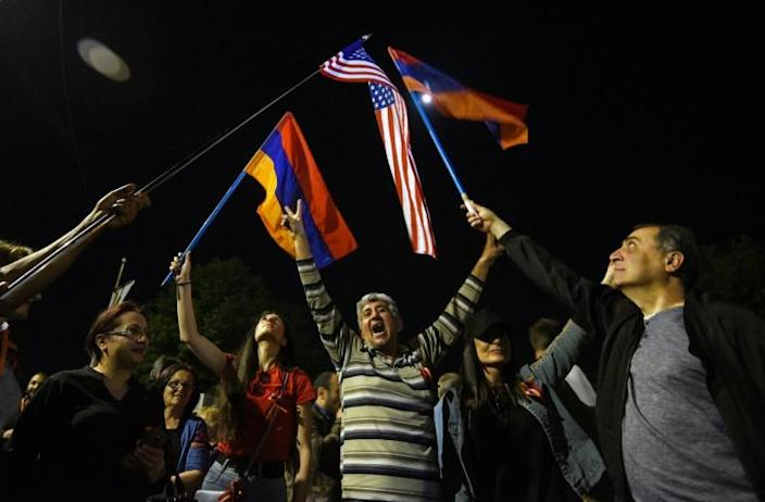 People wave Armenian and US flags in front of the US embassy in Yerevan after US President Joe Biden recognised the 1915 killings of Armenians by Ottoman forces as genocide