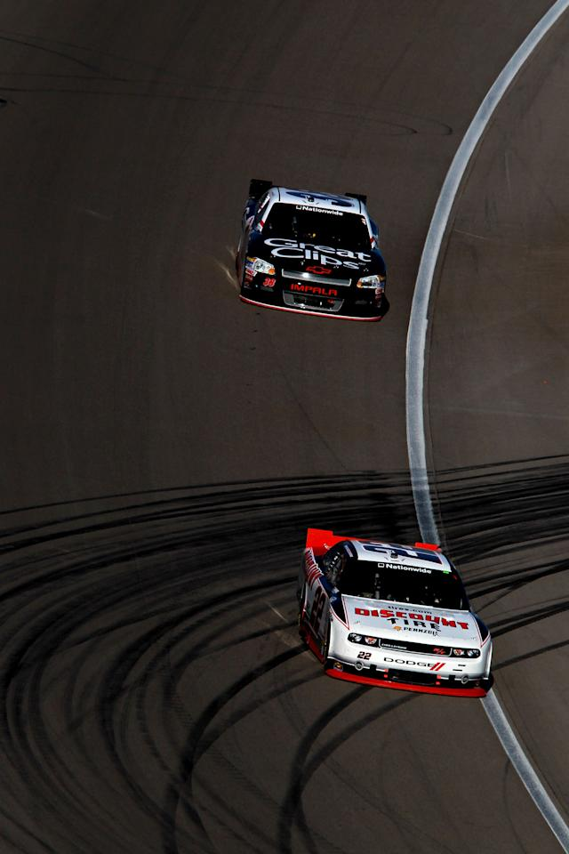 LAS VEGAS, NV - MARCH 10:  Brad Keselowski, driver of the #22 Discount Tire Dodge, leads Kasey Kahne, driver of the #38 Great Clips Chevrolet, during the NASCAR Nationwide Series Sam's Town 300 at Las Vegas Motor Speedway on March 10, 2012 in Las Vegas, Nevada.  (Photo by Ronald Martinez/Getty Images for NASCAR)