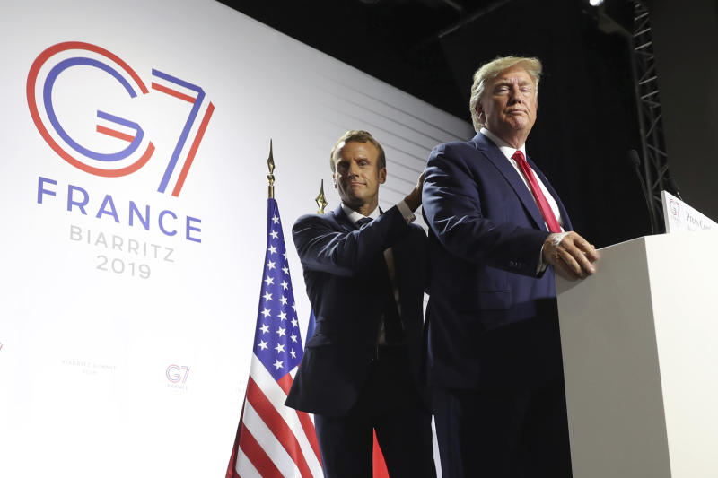 FILE - In this Aug. 26, 2019 file photo, President Donald Trump and French President Emmanuel Macron wrap up a joint press conference at the G-7 summit in Biarritz, France. With entire countries on lockdown, state visits canceled and key meetings postponed or moved online, the coronavirus pandemic may have significant implications for weighty matters of war and peace, arms control and human rights. (AP Photo/Andrew Harnik)