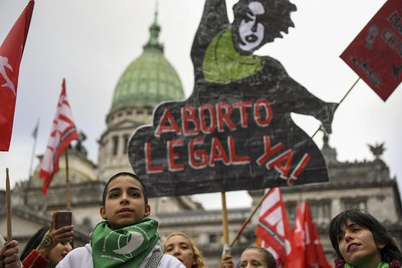 Activists calling for the approval of a bill that would legalize abortion demonstrate in front of the Argentine Congress in Buenos Aires