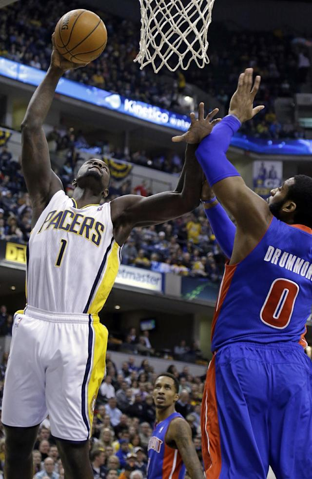 Indiana Pacers guard Lance Stephenson, left, shoots over Detroit Pistons center Andre Drummond in the second half of an NBA basketball game in Indianapolis, Monday, Dec. 16, 2013. The Pistons defeated the Pacers 101-96. (AP Photo/Michael Conroy)