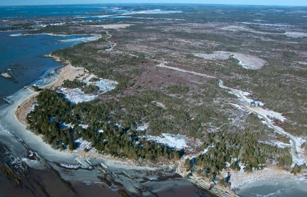 This picture shows Little Harbour in the upper left, private land in the foreground, and the Owls Head park reserve in the upper right.  (Nova Scotia Nature Trust - image credit)