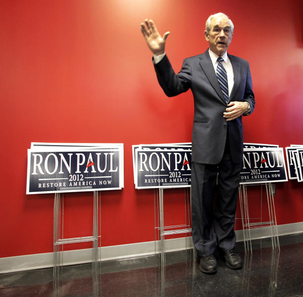 FILE - This Dec. 28, 2011 file photo shows then-Republican presidential candidate, Rep. Ron Paul, R-Texas waiting to be introduced during a campaign stop at the Iowa Speedway in Newton, Iowa. Ron Paul is exiting the political stage but his legions of rabble-rousing followers insist they are only getting started. Libertarian-leaning loyalists of the two-time Republican presidential candidate have quietly taken over key-state GOP organizations, ensuring future fights with the GOP's establishment and laying the groundwork for a future presidential candidate. (AP Photo/Charlie Riedel, Fiel)