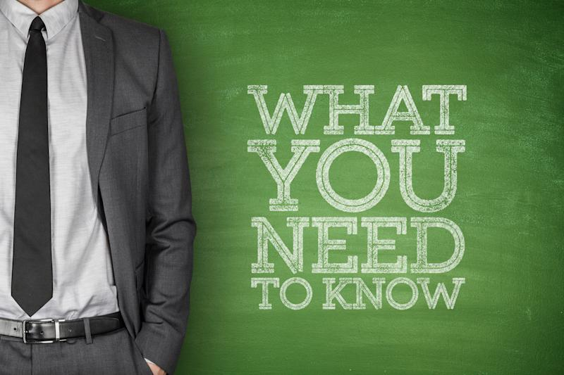 A torso of a man in a suit, next to a green board with the words what you need to know.