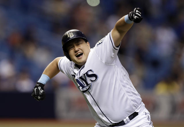 Tampa Bay Rays' Ji-Man Choi, of South Korea, celebrates his two-run walk off home run off Cleveland Indians pitcher Brad Hand during the ninth inning of a baseball game Monday, Sept. 10, 2018, in St. Petersburg, Fla. The Rays won the game 6-5. (AP Photo/Chris O'Meara)