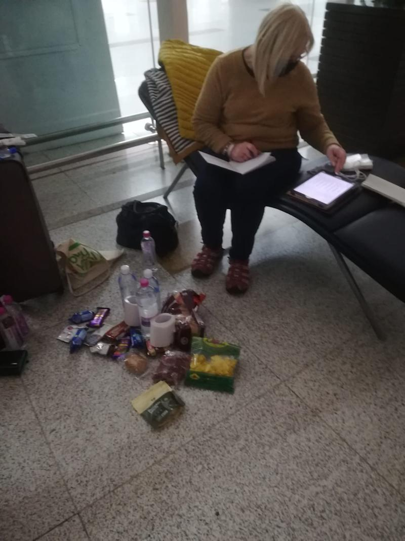 The women are sleeping in the airport terminal and eating snacks. (Picture: Diane Want)
