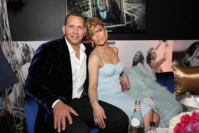<p>Is it hot in here? The sexy couple stayed close at the Guess Spring 2018 campaign reveal in Los Angeles on Wednesday night, starring none other than J.Lo herself. (Photo: Rachel Murray/Getty Images for Guess, Inc.) </p>
