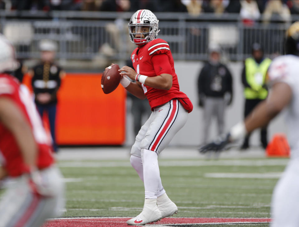 Ohio State quarterback Justin Fields drops back to pass against Maryland during the first half of an NCAA college football game, Saturday, Nov. 9, 2019, in Columbus, Ohio. (AP Photo/Jay LaPrete)