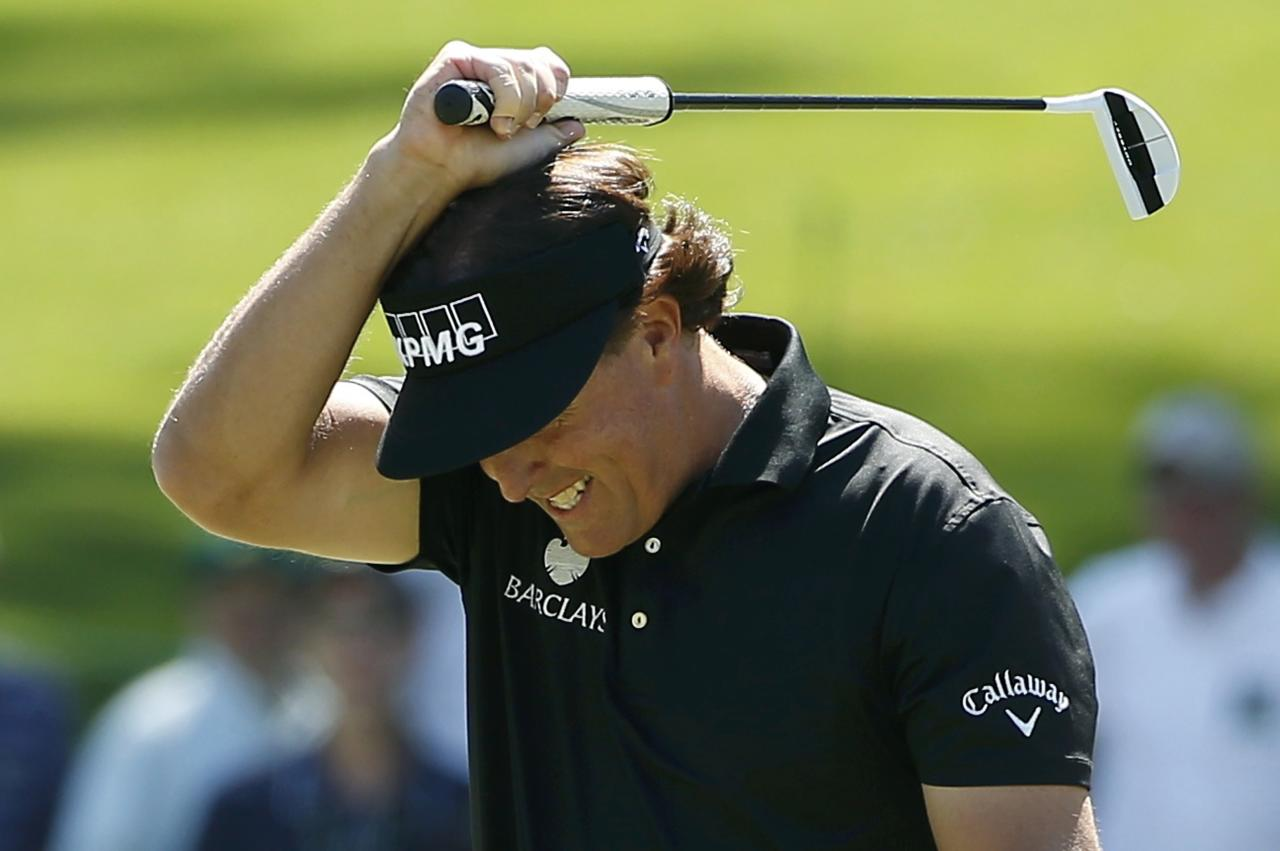 U.S. golfer Phil Mickelson reacts after missing a putt on the sixth hole during the first round of the 2014 Masters golf tournament at the Augusta National Golf Club in Augusta, Georgia April 10, 2014. REUTERS/Jim Young (UNITED STATES - Tags: SPORT GOLF)