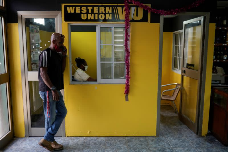 A man talks on the phone outside a Western Union office, in Havana